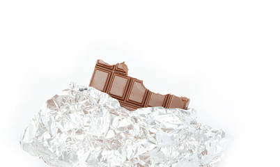 Chocolate bar in foil isolated on white background