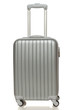 Front view of silver travel suitcase standing over white