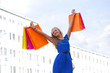 woman rising up shopping bags