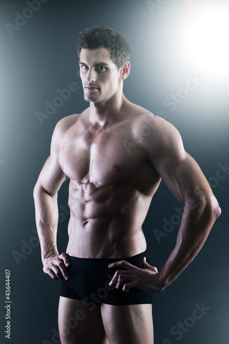 Portrait of a young sexy shirtless man in underwear