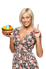 Female holding basket with Easter eggs with her finger up