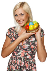 Happy female holding basket with Easter eggs
