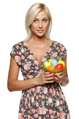 Young female holding basket with Easter eggs