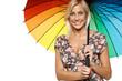 Beautiful blond female in sundress under umbrella