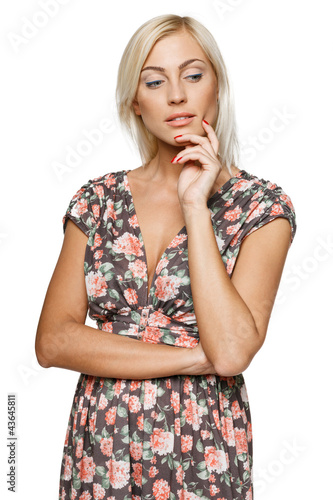 Pensive female in sundress looking down