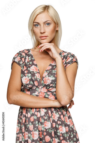 Portrait of female in summer dress standing with folded hands