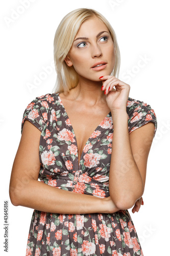 Pensive female in sundress looking sideways