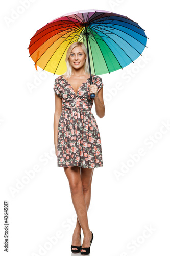 Full length of female in summer dress standing under umbrella