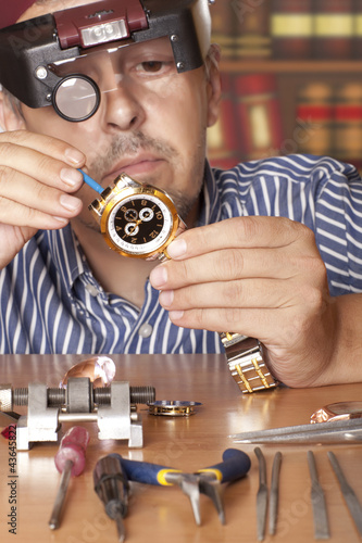 Watch repair craftsman repairing watch