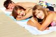 Friends sunbathing
