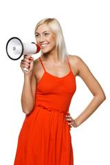 Female in red sundress proclaiming into the loudspeaker
