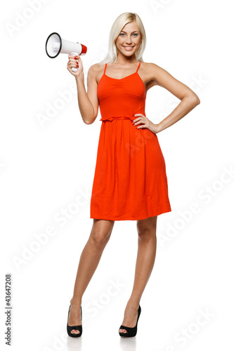 Full length of female in red dress holding loudspeaker