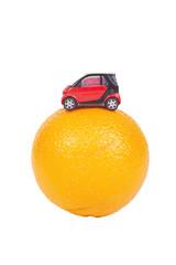 toy car on the orange isolated on white background