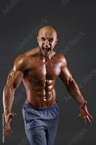 Portrait of muscular screaming men