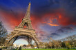 Eiffel Tower in Paris under a thunder-charged sky