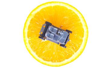 plastic car parts on the orange isolated on white background
