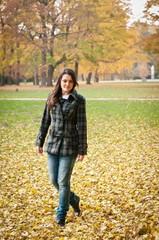 Autumn joy - young woman outdoor