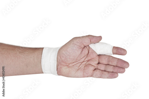 Bandaged finger - isolated over white