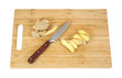 Wood cutting board with ginger root and knife