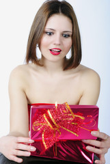 bright beautiful girl with gift