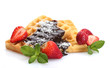 belgium waffles with strawberries and mint  isolated on white