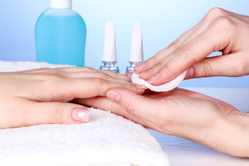 Manicure process in salon