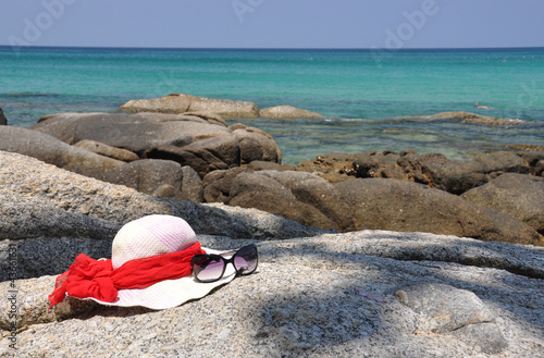 Hat and sunglasses on the rock. Phuket island, Thailand