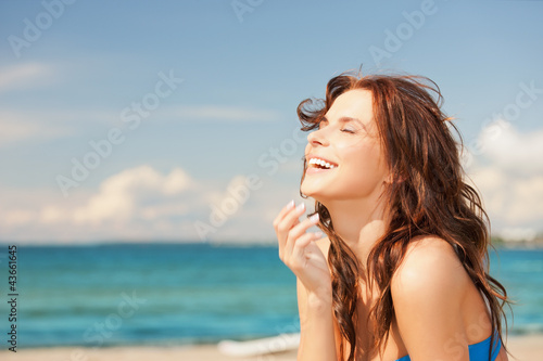 laughing woman on the beach