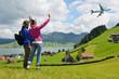 Travelers against rural scenery