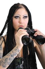 young stylish woman with binoculars