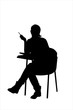 A silhouette of a young female sitting on a school chair