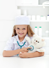 Little girl playing veterinary