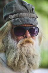 Bearded Man with Cap & Sun Glasses