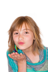young girl blowing a kiss