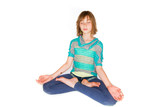 Young girl meditating in a yoga class
