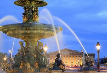 Fountain in Place de la Concorde at dusk, Paris, France