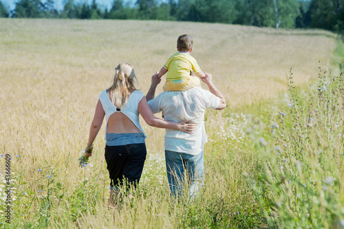 Happy family going in the field