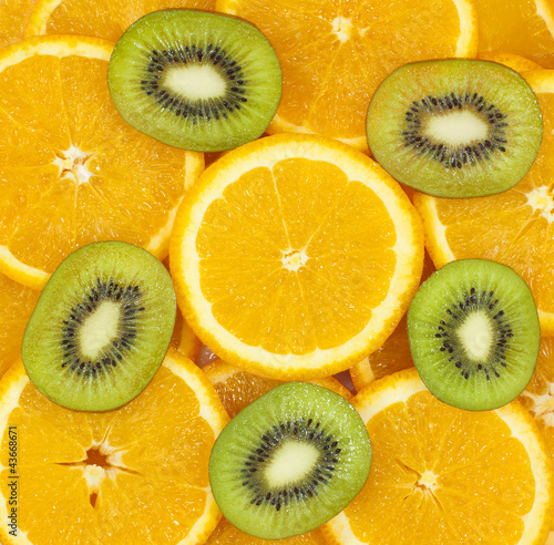 sliced kiwi fruit and citrus orange background
