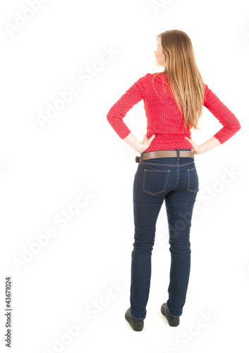 standing backwards young woman, full length