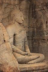 Statue of Buddha carved from a rock, Polonnaruwa, Sri Lanka