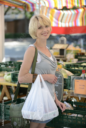 Woman buying vegetables at farmer's market