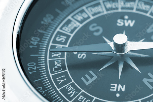 Leinwandbild Motiv compass closeup blue toned