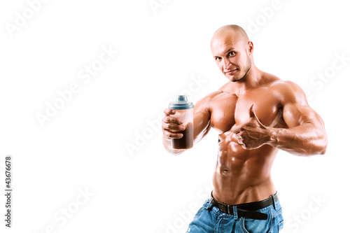 athletic young handsome man with shake bottle.