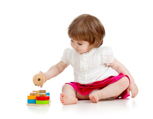 child girl playing with educational toy