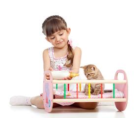 child girl feeding and playing kitten cat