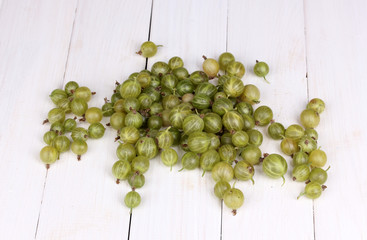 Green gooseberry on wooden background