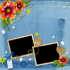 Denim background with frame for photo with flowers, lace and pea