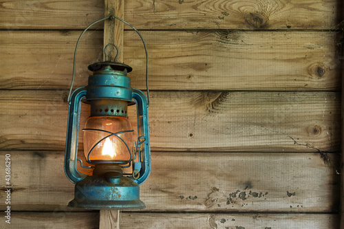 Rusty lantern hanging in a shed - 43686290