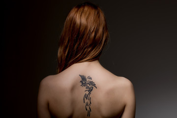 woman with tattooed back