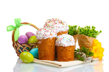 Beautiful Easter cakes, colorful eggs in basket and
